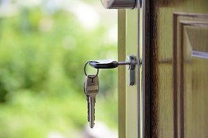 key in door to house