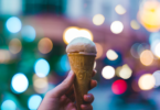 cone with ice cream and lights in the background