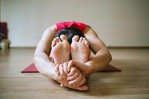 woman bent forward in yoga pose