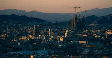barcelona skyline with sun setting
