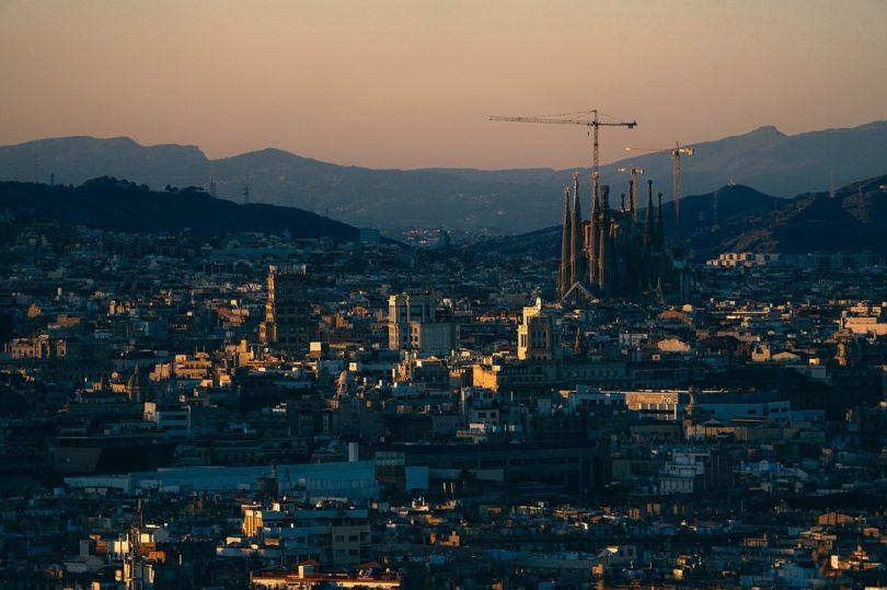 barcelona skyline with sun setting