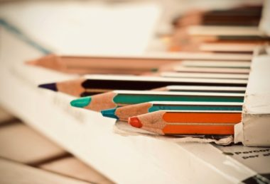 colouring pencils on desk