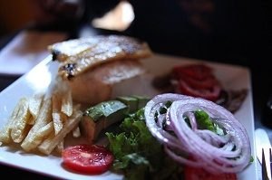 peruvian dish with fries and salad