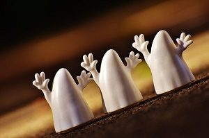 three white ghosts with halloween