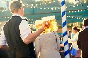 waiter bringing beer at oktoberfest