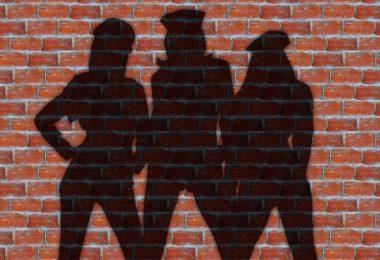 women's silhouette against brick wall
