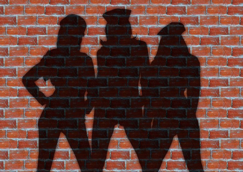 women's silhouette against brick wall