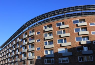 apartment building with blue sky