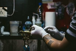 tattoo artist preparing
