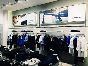 interior clothing shop with black and blue clothes