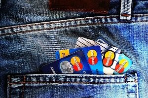 four credit cards in back pocket of jeans