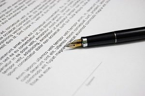 unsigned contract with black pen