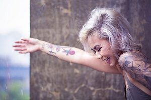happy lady with tattoo on her arm