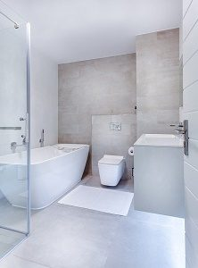 modern, white and grey bathroom with bath