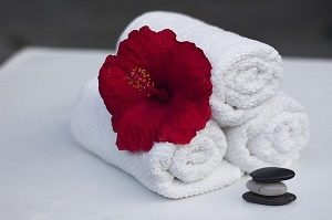three white towel with red flower