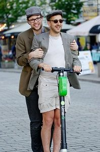 two men on an e-scooter