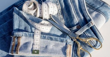 jeans, scissors and measure tape