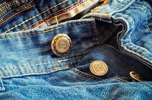 close-up of jeans and buttons