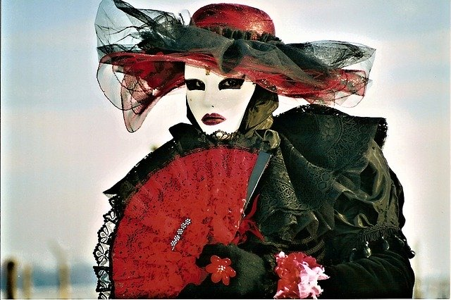 figure dressed in red and black carnival
