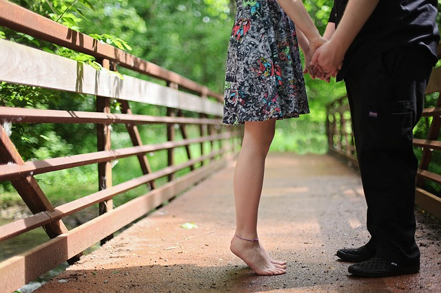couple in spring on a bridge in nature