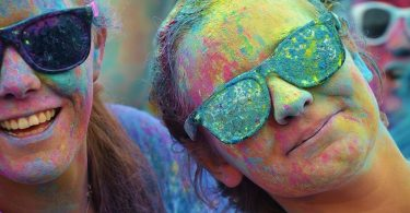 girl with sunglasses and coloured powder
