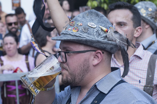 man drinking beer in grey hat