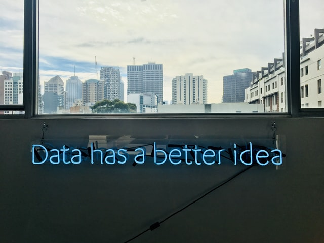 white building with data has a better idea text signage photo