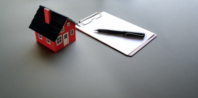 small house with clipboard and pen