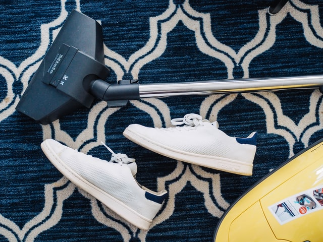 rug with sneakers and vacuum cleaner