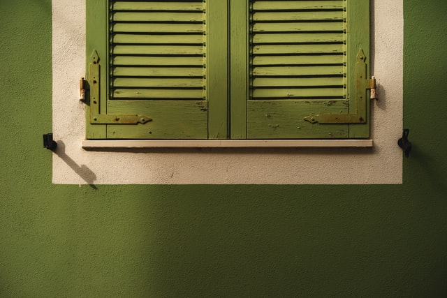 Green wall with green shutters
