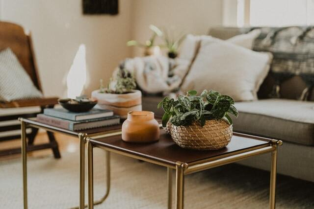 tables with decorations in living room