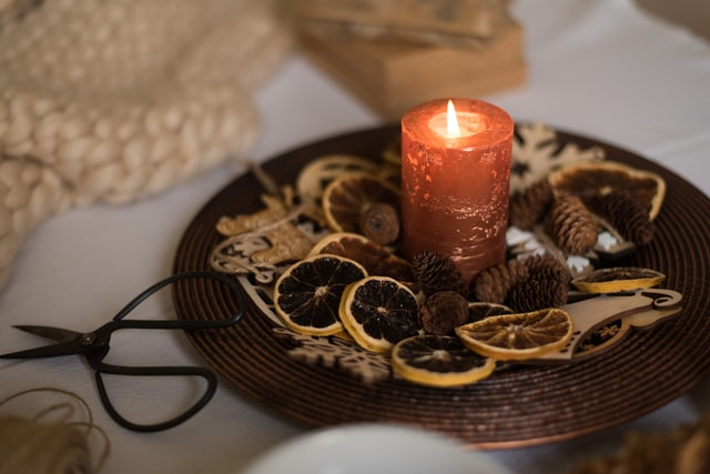 autumn decorations with candle and dried slices of lemon