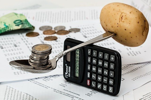 calculator with spoon, potato and coins