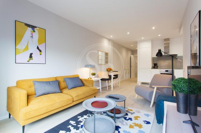student apartments in barcelona with yellow couch
