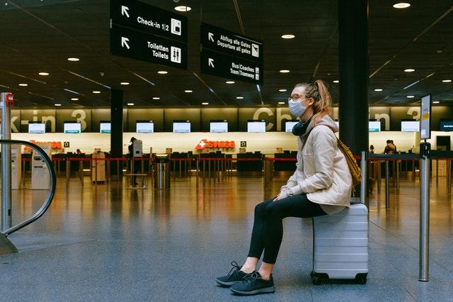 lady sitting on suitcase