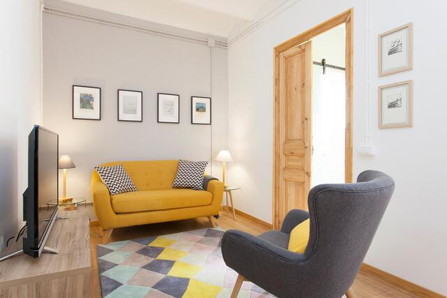 yellow couch with grey chair