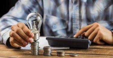 man with light bulb on coins
