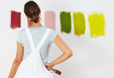 lady with 6 test colours on the wall