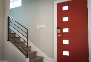 red door and stairs